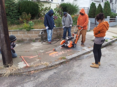 crew using concrete cutter